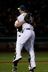 OAKLAND, CA - MAY 07: Mike Fiers #50 of the Oakland Athletics celebrates with Josh Phegley #19 after pitching a no hitter against the Cincinnati Reds at the Oakland Coliseum on May 7, 2019 in Oakland, California. The Oakland Athletics defeated the Cincinnati Reds 2-0. (Photo by Jason O. Watson/Getty Images) *** Local Caption *** Mike Fiers; Josh Phegley