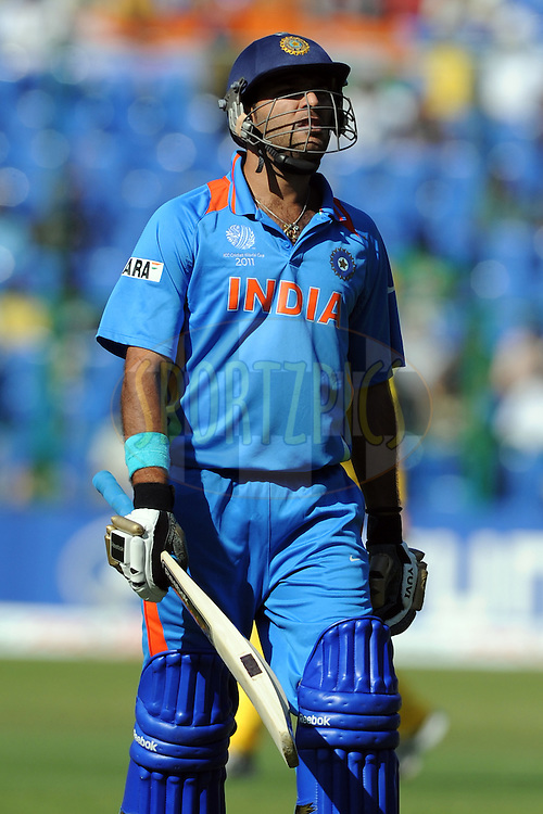 Yuvraj Singh walks back after getting out during the World Cup warm up match between India and Australia (B) held at the M Chinnaswamy Stadium in Bengaluru, Bangalore, Karnataka, India on the 13 February 2011..Photo by Pal Pillai/BCCI/SPORTZPICS