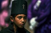 Guatemalan boy in the Holy Week processions, Semana Santa, Antigua, Guatemala
