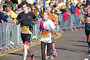 Nicola (2503) and Duncan (3877) at the final 200m mark during The Great South Run in Southsea, Portsmouth, United Kingdom on 23 October 2016. Photo by Jon Bromley.