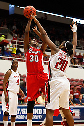 March 19, 2011; Stanford, CA, USA; St. John's Red Storm forward Centhya Hart (30) shoots over Texas Tech Lady Raiders forward/center Kierra Mallard (20) during the first half of the first round of the 2011 NCAA women's basketball tournament at Maples Pavilion. St. John's defeated Texas Tech 55-50.