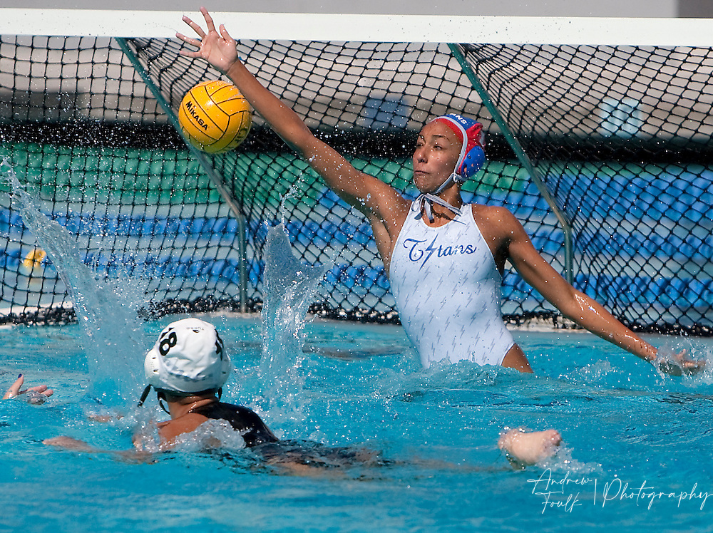 /Andrew Foulk/ For The Californian/ .Bonita's Samantha Snow throw's the ball past Temescal Canyon's Lina Medeiros, during the CIF Southern Section Division V girls water polo championship match.