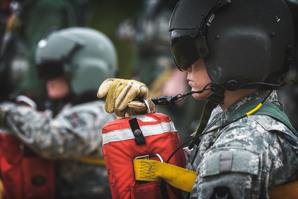 U.S. Army Flight Medic Students wait on line for extraction by rescue hoist