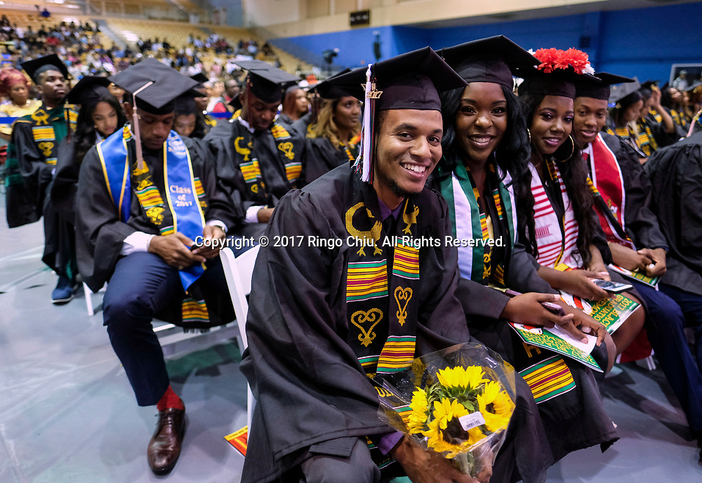 RIVERSIDE, CA - JUNE 11, 2017: Graduate Alexander Wilson, front, in the Black Graduation Ceremony at University of California, Riverside, Sunday June 11, 2017. (Photo by Ringo H.W. Chiu / For The Times)(Photo by Ringo Chiu)<br /> <br /> Usage Notes: This content is intended for editorial use only. For other uses, additional clearances may be required.