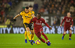 WOLVERHAMPTON, ENGLAND - Friday, December 21, 2018: Liverpool's Naby Keita (R) and Wolverhampton Wanderers' Romain Saïss during the FA Premier League match between Wolverhampton Wanderers FC and Liverpool FC at Molineux Stadium. (Pic by David Rawcliffe/Propaganda)
