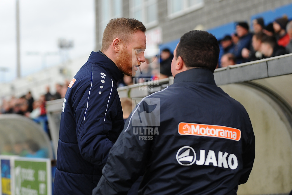 TELFORD COPYRIGHT MIKE SHERIDAN Gavin Cowan greets opposite number Paul Cox  during the Vanarama Conference North fixture between AFC Telford United and Kettering at The New Bucks Head on Saturday, March 14, 2020.<br /> <br /> Picture credit: Mike Sheridan/Ultrapress<br /> <br /> MS201920-050
