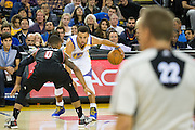 Portland Trail Blazers guard Damian Lillard (0) defends Golden State Warriors guard Stephen Curry (30) late in the second quarter at Oracle Arena in Oakland, Calif., on October 21, 2016. (Stan Olszewski/Special to S.F. Examiner)