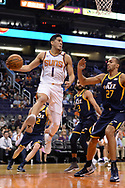 Oct 25, 2017; Phoenix, AZ, USA; Phoenix Suns guard Devin Booker (1) makes a pass in front of Utah Jazz center Rudy Gobert (27) in the first half at Talking Stick Resort Arena. Mandatory Credit: Jennifer Stewart-USA TODAY Sports