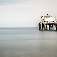 Malibu Pier panorama photo in Southern California. Malibu is a beach city along the Pacific Ocean in the Western United States.