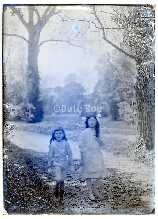 two young girls walking in a park France circa 1920s