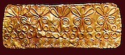 Gold funery diadem circa 1450-1200 BC from Enkomi. Enkomi in north-western Cyprus is the site of an important Bronze Age city, possibly the capital of Alasiya. Enkomi was settled in the Middle Bronze Age, near an inlet of the sea, now silted to form a plain. From about the 16th century BC to the 12th