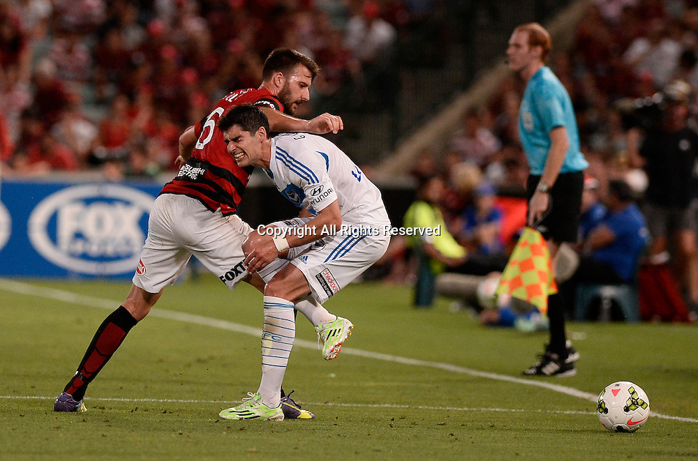 06.01.2015. Sydney, Australia. Hyundai A-League Round 14. Western Sydney Wanderers FC v Melbourne Victory FC.Wanderers defender Antony Golec  and Victory midfielder Gui Finkler. Victory won the game 2-1.