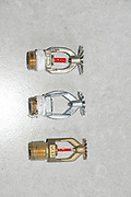 Three varieties of automatic Fire Sprinklers on white background