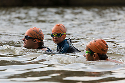 © Licensed to London News Pictures. 31/08/2018. London, UK.  Participants, including Wilf Pryor, aged 8 (centre) with his father take part in the Tidal River Swim in Hammersmith this evening, launching this years Thames Festival. Over 100 brave enthusiasts took part in a 30 minute swim, as they followed the tide towards Chiswich Eycot and back. Photo credit: Vickie Flores/LNP