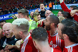 LILLE, FRANCE - Friday, July 1, 2016: Wales players celebrate a 3-1 victory over Belgium and reaching the Semi-Final during the UEFA Euro 2016 Championship Quarter-Final match at the Stade Pierre Mauroy. captain Ashley Williams. (Pic by David Rawcliffe/Propaganda)