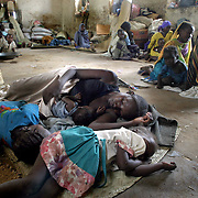 June 12, 2004 - Displaced people take refuge at a school in the town of Kass where 33,000 displaced people have set up camp after fleeing their villages.  The international aid organization, CARE, in is distributing food to the IDP's in Kass, Darfur, Sudan. Photo by Evelyn Hockstein/CARE