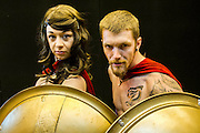 Tash Fountain, 23, and Kasey Woolfe, 25 (both from Devon), play soldiers from 300 Spartans. He rides a motorbike, when not in costume, and claims he is rarely 'out of leather'. London Film and Comic Con 2014, (LFCC), at Earls Court, London, UK.