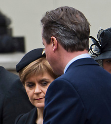 © London News Pictures. 08/05/2015. British Prime minister DAVID CAMERON walks past SNP leader NICOLA STURGEON durig the VE day ceremony on Whitehall, London on the day David Cameron formed a majority government. Photo credit: Ben Cawthra/LNP