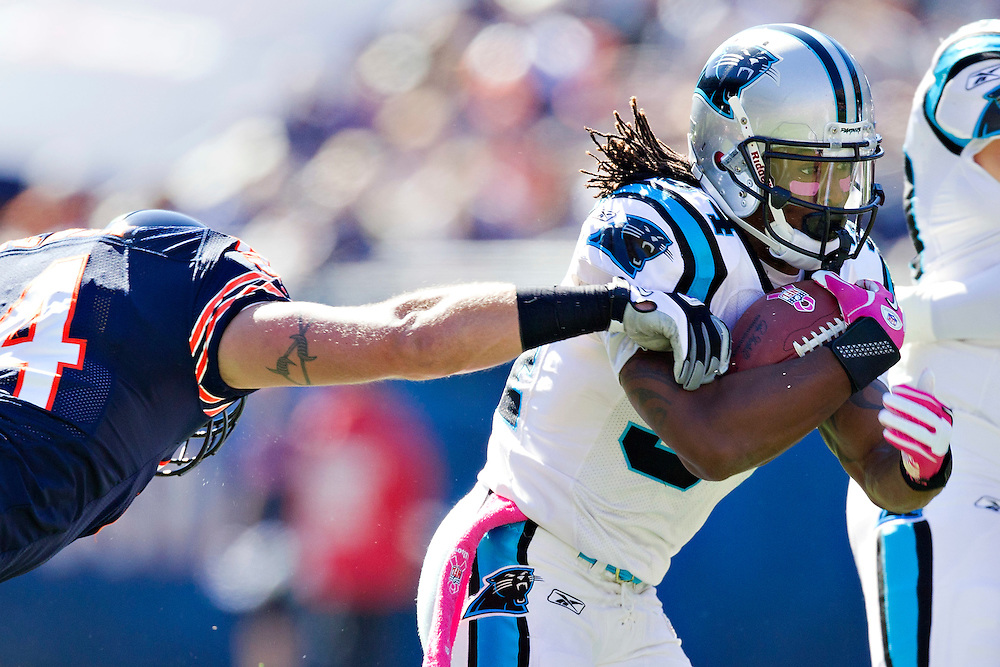 CHICAGO, IL - OCTOBER 2:   DeAngelo Williams #34 of the Carolina Panthers runs the ball against the Chicago Bears at Soldier Field on October 2, 2011 in Chicago, Illinois.  The Bears defeated the Panthers 34 to 29.  (Photo by Wesley Hitt/Getty Images) *** Local Caption *** DeAngelo Williams