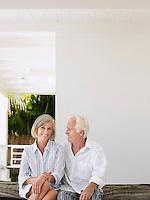 Senior couple sitting on verandah portrait