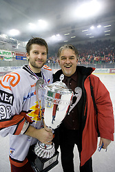 Tomo Hafner of Acroni Jesenice and Zoran Racic  celebrate with a Trophy  at 6th Round of ice-hockey Slovenian National Championships match between HDD Tilia Olimpija and HK Acroni Jesenice, on April 2, 2010, Hala Tivoli, Ljubljana, Slovenia.  Acroni Jesenice won 3:2 after overtime and became Slovenian National Champion 2010. (Photo by Vid Ponikvar / Sportida)