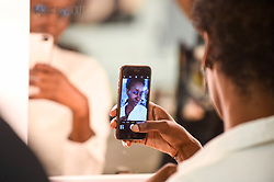 © Licensed to London News Pictures. 14/09/2019. LONDON, UK.  A model takes a selfie backstage ahead of the Simon Mo show during Fashion Scout SS20, an off schedule show at Victoria House in Bloomsbury Square, during London Fashion Week.  Photo credit: Stephen Chung/LNP
