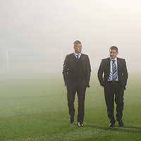 St Johnstone v Aberdeen game called off due to thick fog at McDiarmid Park in Perth....07.11.11<br /> Pictured Manager Steve Lomas and Chairman Steve Brown on the fog bound pitch.<br /> Picture by Graeme Hart.<br /> Copyright Perthshire Picture Agency<br /> Tel: 01738 623350  Mobile: 07990 594431