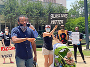 June 1, 2020 Jackson, MS Demonstrator and activist Adolfo Minka, attorney, speaks his mind and talks with other demonstrators our side the Mississippi State Capitol. <br />
