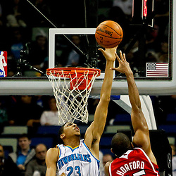 Jan 1, 2013; New Orleans, LA, USA; New Orleans Hornets power forward Anthony Davis (23) blocks a shot by Atlanta Hawks center Al Horford (15) during the second quarter of a game at the New Orleans Arena. Mandatory Credit: Derick E. Hingle-USA TODAY Sports