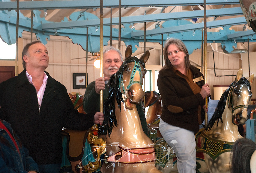 Scott Wolfe and Johnny Lewis listen as tour guide Donna Savell tells them the history of the Dentzel Carousel Jan. 15, 2011 in Meridian, Miss. The carousel, which was built in 1896, is hand-carved and painted and is listed on the National Register of Historic Places. It is one of only 11 carousels nationwide to be named a National Landmark, and it is located in the only carousel building that remains from Dentzel's original blueprint. The carousel is open on Saturdays from 1 p.m. to 5 p.m. through March. Rides are 50 cents per person. (Photo by Carmen K. Sisson/Cloudybright)