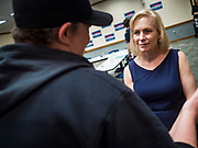 """24 MAY 2019 - WEST DES MOINES, IOWA: US Senator KIRSTEN GILLIBRAND (D-NY) talks to an Iowan after Gillibrand's forum on family rights in the West Des Moines Public Library. Gillibrand unveiled her """"Family Bill of Rights"""" during a forum in West Des Moines. The New York Senator has made family health and rights a centerpiece of her campaign. She is touring Iowa this week to support her candidacy to be the Democratic nominee for the US Presidency. Iowa traditionally hosts the the first selection event of the presidential election cycle. The Iowa Caucuses will be on Feb. 3, 2020.           PHOTO BY JACK KURTZ"""
