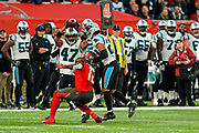 Carolina Panthers Defensive Back Ross Cockrell (47) intercepts the ball during the International Series match between Tampa Bay Buccaneers and Carolina Panthers at Tottenham Hotspur Stadium, London, United Kingdom on 13 October 2019.