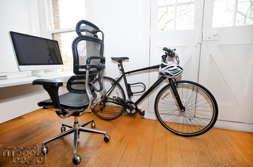 PC, Desk and Bicycle inside an office