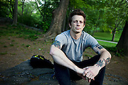 Ryan Jordan sits on a rock in New York City's Central Park.