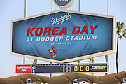 LOS ANGELES, CA - JULY 28:  The stadium scoreboard promotes Korea Day at Dodger Stadium presented by the Korea Tourism Organization before the Los Angeles Dodgers game against the Cincinnati Reds on Sunday, July 28, 2013 at Dodger Stadium in Los Angeles, California. The Dodgers won the game in a 1-0 shutout. (Photo by Paul Spinelli/MLB Photos via Getty Images)