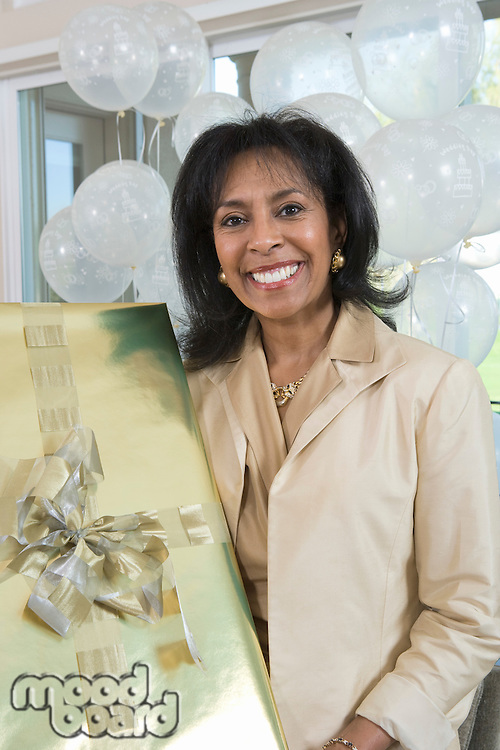 Woman holding gift at party