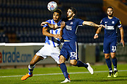 Colchester United forward Mikael Mandron (19) Southend United defender Stephen Hendrie battles for possession during the EFL Trophy match between Colchester United and Southend United at the Weston Homes Community Stadium, Colchester, England on 9 October 2018.