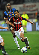 Ronaldinho of Milan is chased by Patrick Vieira during the Serie A match between AC Milan and Inter Milan at the Stadio Giuseppe Meazza on September 28, 2008 in Milan, Italy.