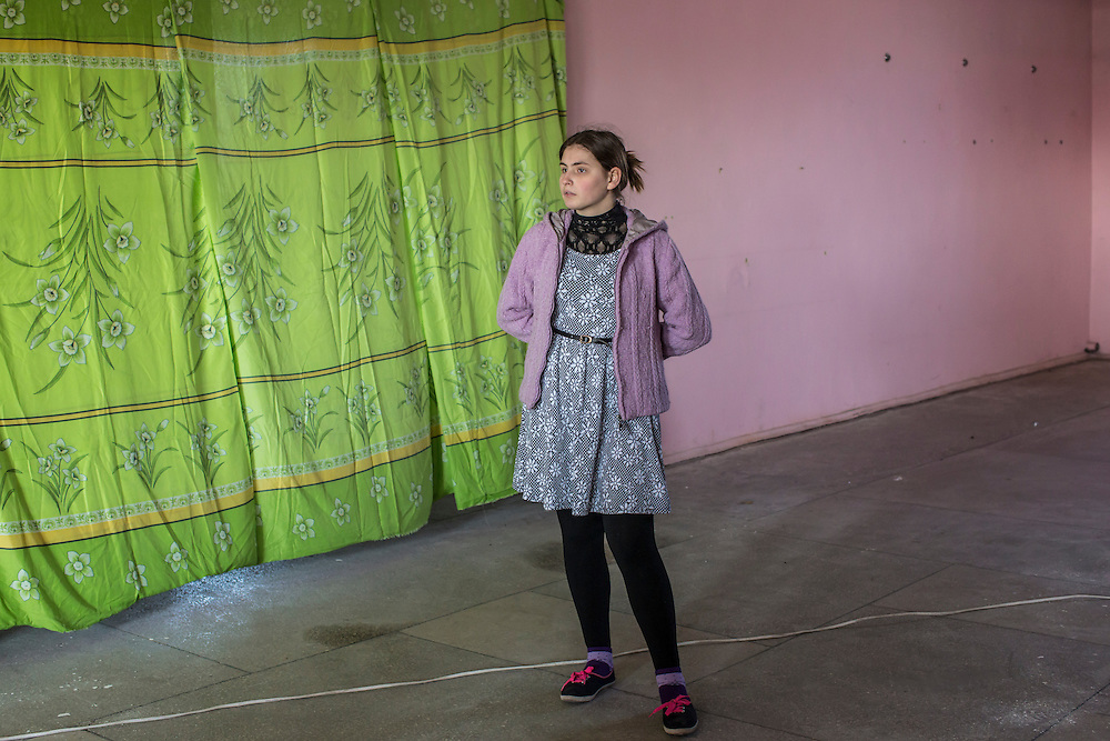 MARIINKA, UKRAINE - FEBRUARY 20, 2016:  A congregant listens to a service at the Christian Help Center of the Church of the Transfiguration in Mariinka, Ukraine. The Donetsk suburb has been the scene of some of the heaviest fighting recently between Ukrainian forces and pro-Russian rebels. CREDIT: Brendan Hoffman for The New York Times