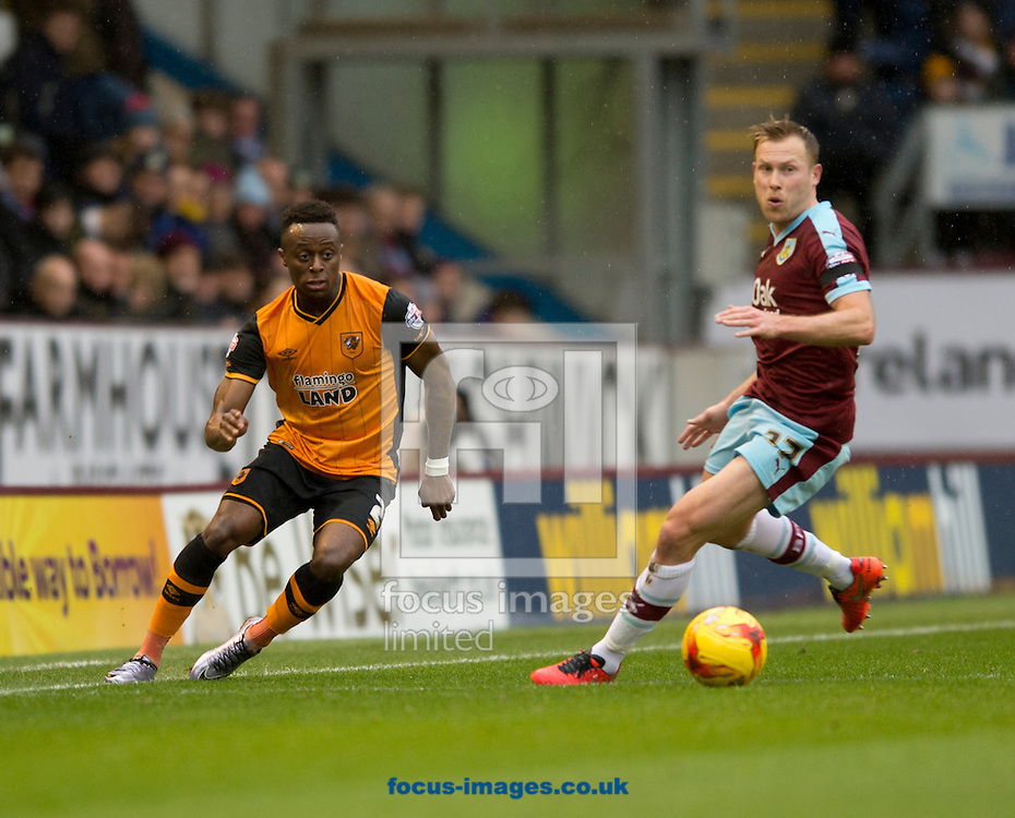 Moses Odubajo of Hull City (left) plays the ball forward as Scott Arfield of Burnley closes down during the Sky Bet Championship match at Turf Moor, Burnley<br /> Picture by Russell Hart/Focus Images Ltd 07791 688 420<br /> 06/02/2016