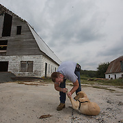 BOYDS, MD - SEP09: Veteran Rory Ready, checks the paw of his service dog Maria, at the Warrior Canine Connection in Boyds, Maryland. (Photo by Evelyn Hockstein/For The Washington Post)