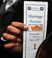 Angelisa Young holds a Marriage Bureau ticket indicating she and her partner of 12 years, Sinjoyla Townsend, as the first to apply for a marriage license outside of District of Columbia Superior Court in Washington on March 3, 2010. In December 2009, the DC Council approved a bill that would allow for same-sex marriages to be performed in the District. Opponents of gay marriage attempted to block the law, but the U.S. Supreme Court yesterday declined to intervene. (photo by Alexis C. Glenn/UPI)