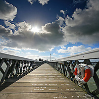 The wide-angle lens and low point-of-view helps to create a dramatic vanishing point looking back towards the town from Yarmouth Pier on the Isle of Wight.<br /> <br /> Two shot vertical panorama created from two frames using the Sigma 10-20mm at f10 1/250<br /> <br /> Part of the Ocean Seen - Oceanic Photography Exhibition.<br /> <br /> Sponsored by Wightlink - Dimbola Museum & Galleries, Freshwater Bay, Isle of Wight - 29th June to 2nd September 2012.<br /> <br /> A collaborative summer show, bringing together three great oceanic photographers to celebrate the way we interact with our great British coastline.