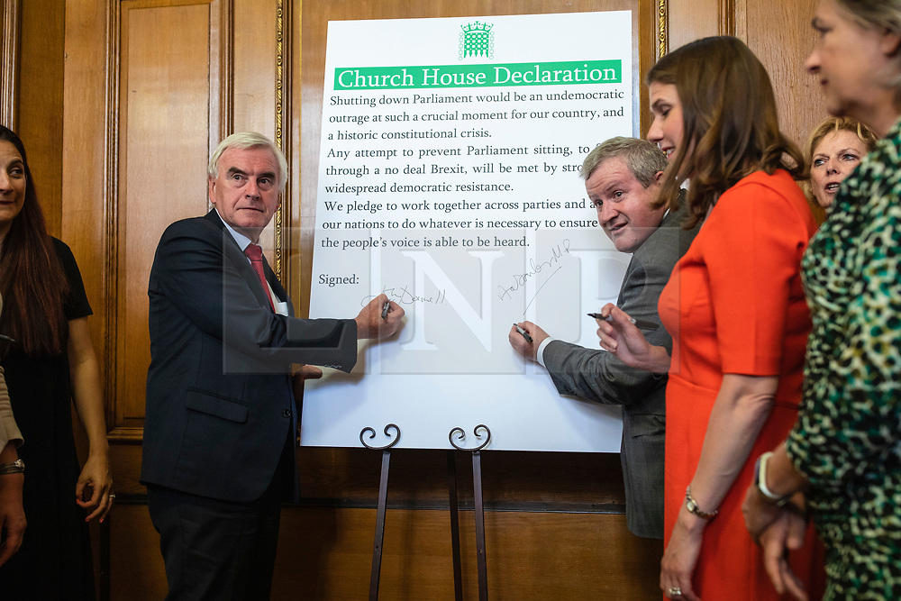 © Licensed to London News Pictures. 27/08/2019. London, UK. Shadow Chancellor John McDonnell and SNP Westminster Leader Ian Blackford Party sign the 'Church House Declaration' to assert their commitment to avoiding a no deal exit from the EU. Photo credit: Rob Pinney/LNP