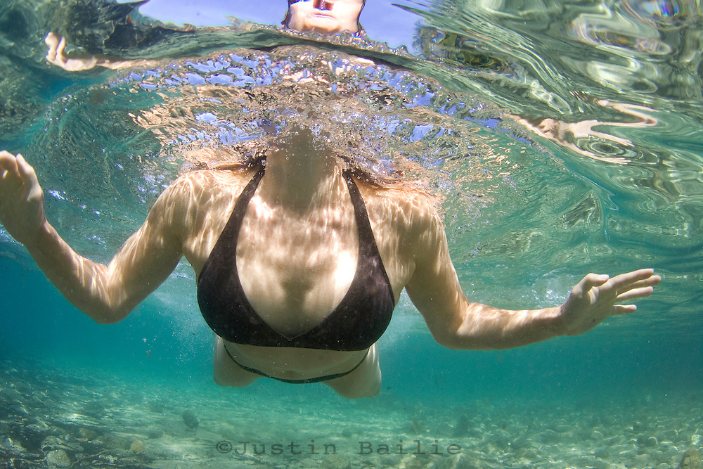 Portrait of young woman swimming underwater taken in Lake Tahoe, CA