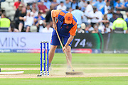 Ground staff working on the wicket during the drinks break during the ICC Cricket World Cup 2019 semi final match between Australia and England at Edgbaston, Birmingham, United Kingdom on 11 July 2019.