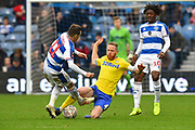 Josh Scowen (11) of Queens Park Rangers is tackled by Adam Forshaw (4) of Leeds United during the The FA Cup 3rd round match between Queens Park Rangers and Leeds United at the Loftus Road Stadium, London, England on 6 January 2019.