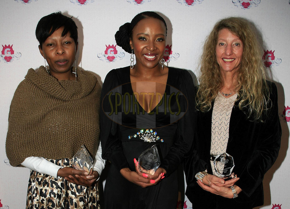 JOHANNESBURG, SOUTH AFRICA: Beverly Maphangwa ( Woman in media), Uyanda Mbuli (Style Star of the year), Clare Vale (Clinique Personal Account Writer of the year) during the 4th annual Gsport Awards on 30 July 2009 held at the Wanderers ClubPhoto by Trevor Kolk/www.sportzpics.net