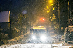 © Licensed to London News Pictures. 10/12/2017. Loggerheads UK. Vehicle's travel along a snow covered road in the village of Loggerheads this morning as Heavy snow has begun falling in Shropshire. Photo credit: Andrew McCaren/LNP