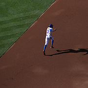 Curtis Granderson, New York Mets, running to second in the late afternoon light after getting on base with a single during the New York Mets Vs Washington Nationals MLB regular season baseball game at Citi Field, Queens, New York. USA. 4th October 2015. Photo Tim Clayton